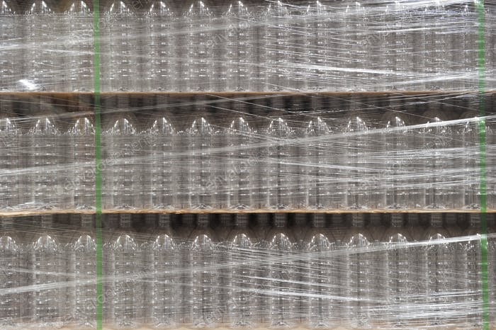 Closeup of pallets of bottled water in a bottling plant.