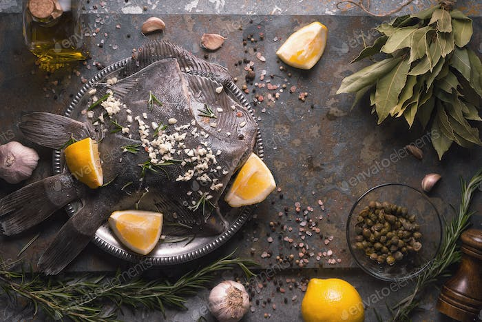 Still life with raw flounders and seasoning