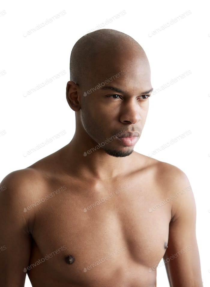 Portrait of a handsome male fashion model shirtless