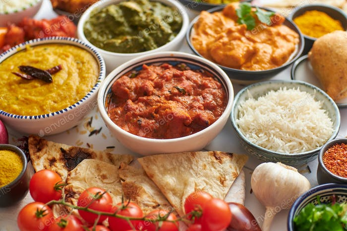 Assorted Indian various food with spices, rice and fresh vegetables
