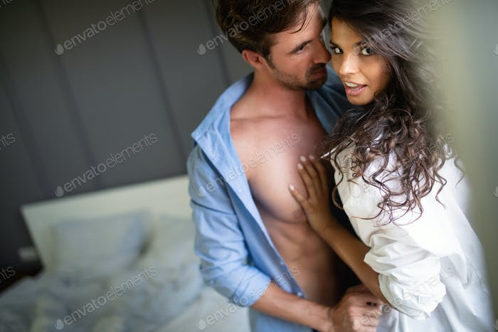 Young sexy hot couple in love hugging and kissing
