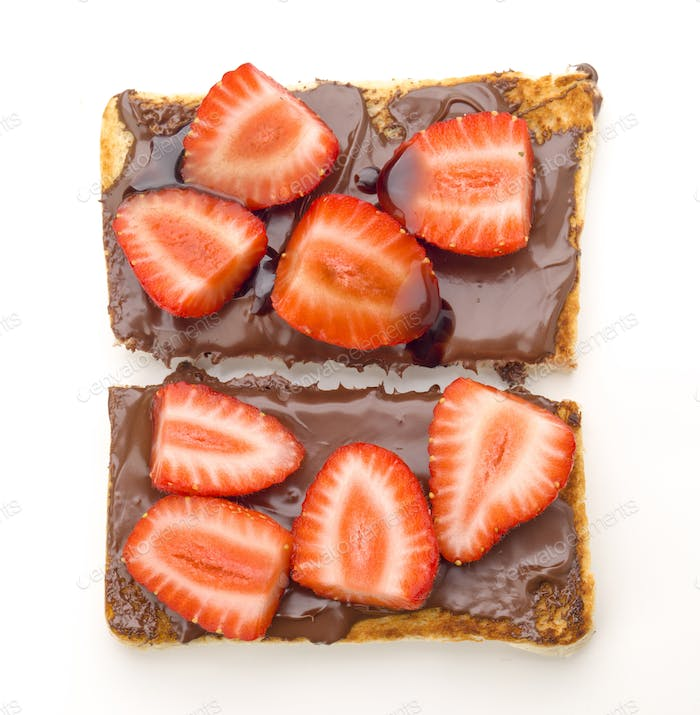 overhead shot of chocolate toast with sliced strawberries, isolated on white