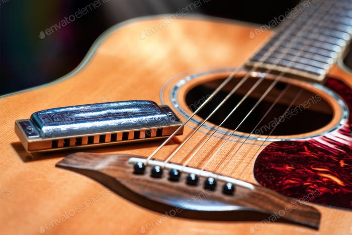 Acoustic guitar with blues harmonica
