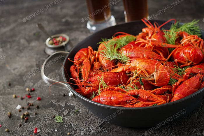 Crayfish. Red boiled crawfishes on table in rustic style, closeup. Lobster closeup. Border design