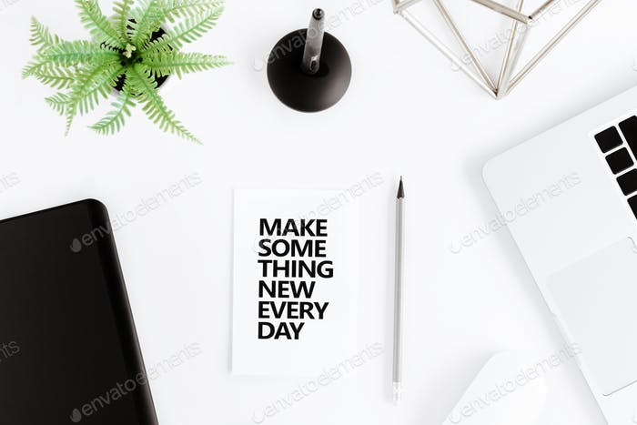flat lay with Make something new everyday motivational quote on modern workplace with wireless