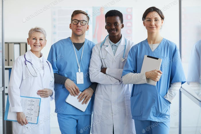 Multi-Ethnic Group of Doctors Posing in Clinic