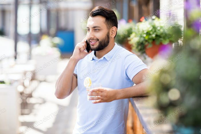 Handsome Middle-Eastern Man Speaking by Phone