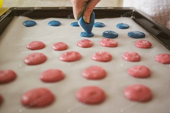 woman artisan baking macarons at home