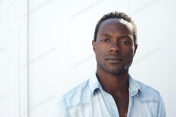 Portrait of a handsome black man against white background