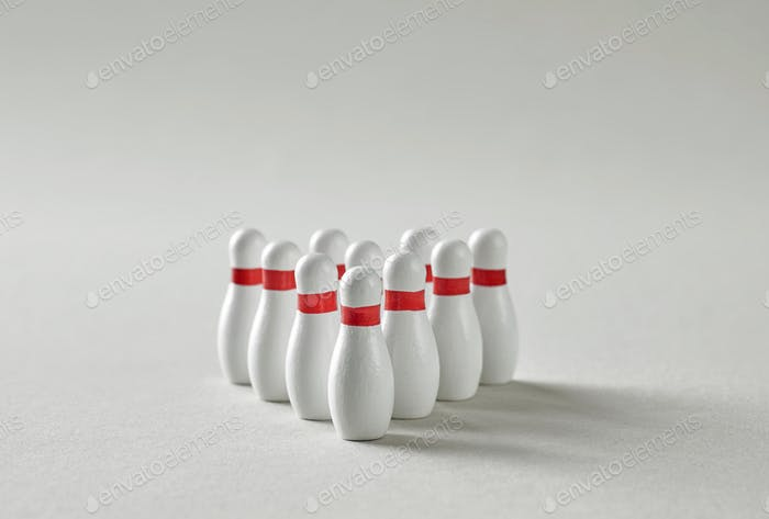 bowling pins on grey background