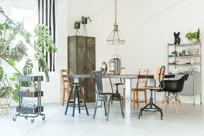 Trendy dining room with table