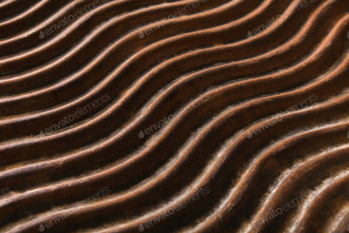 Bronze wavy pattern, decorative background.