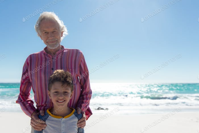 Grandfather and grandson at the beach