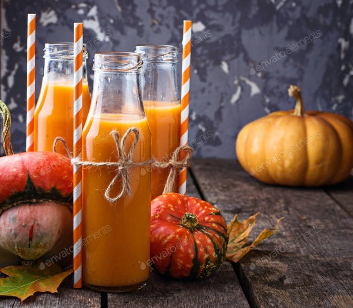 Pumpkin juice in bottles. Autumn drink