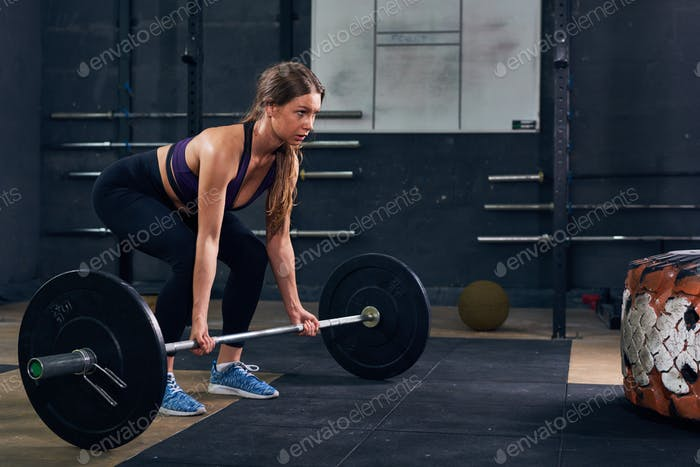 Thumbnail for Woman Lifting Heavy Barbell in CrossFit Gym