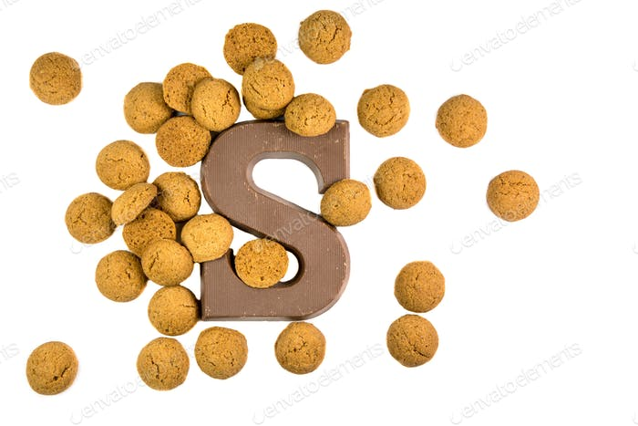 Handful of Pepernoten cookies with chocolate letter