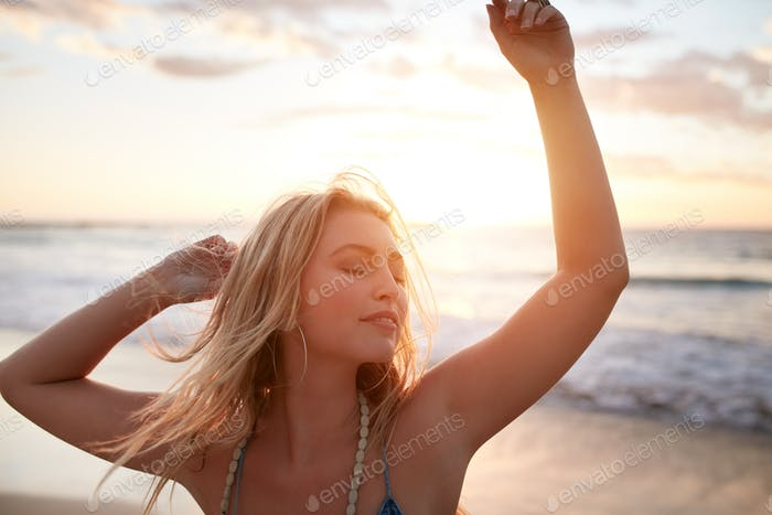 Gorgeous young woman enjoying summer vacation