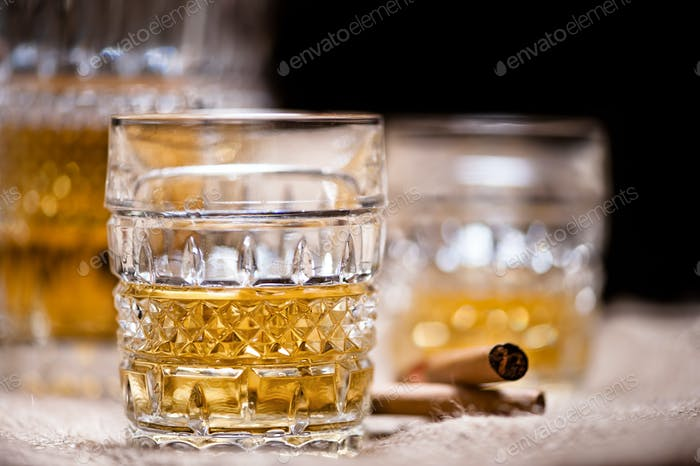 Whiskey, vintage style with cigar and bottle