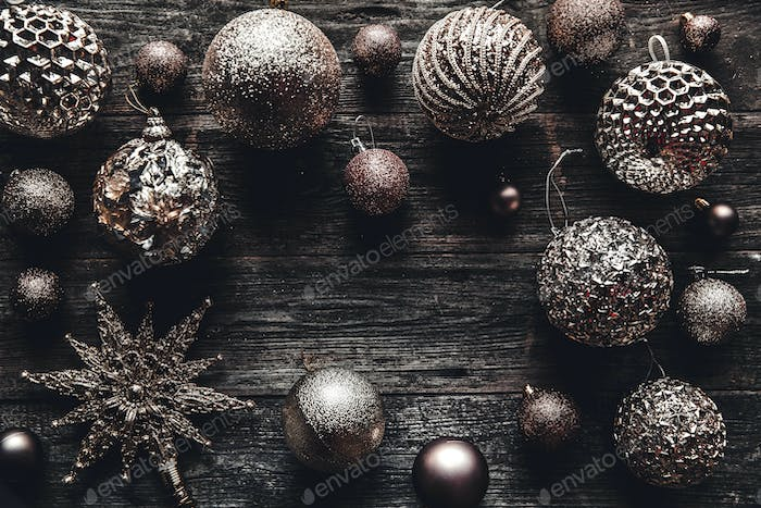 Christmas or New Year background. Vintage Christmas tree toy decoration balls over rustic wooden