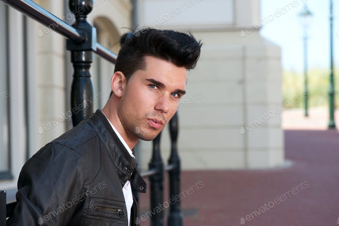 Portrait of a handsome young man in black leather jacket