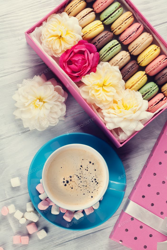 Colorful macaroons, coffee. Sweet macarons