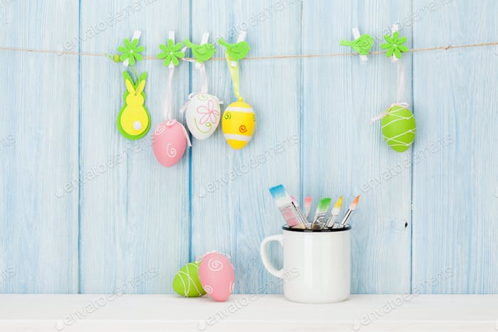 Colorful easter eggs and paintbrushes