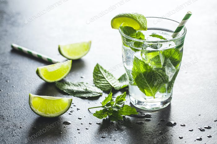 Cocktail with lime, mint and ice cubes.
