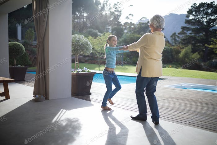Granddaughter and grandmother enjoying near the pool
