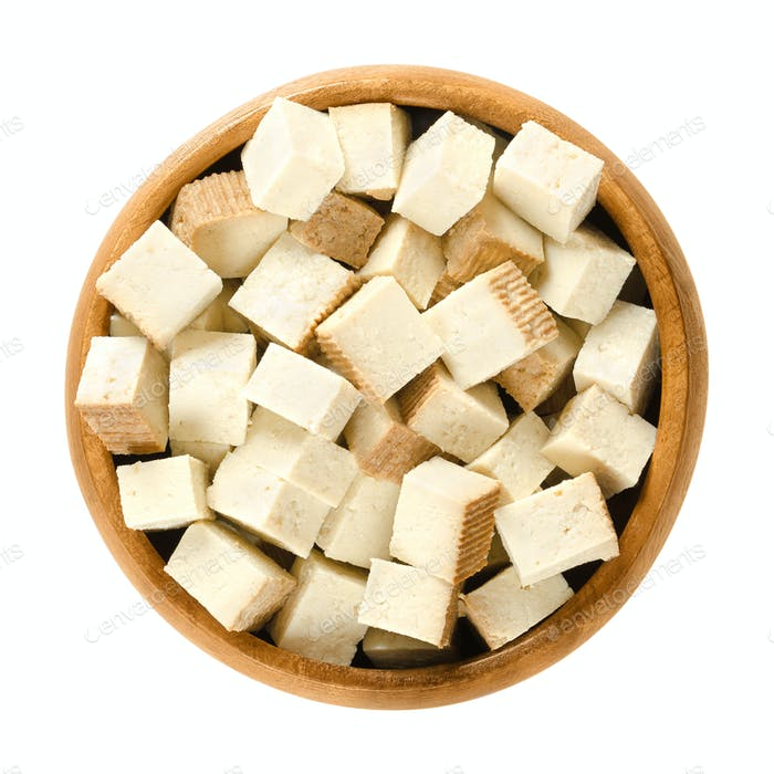 Smoked tofu cubes in wooden bowl