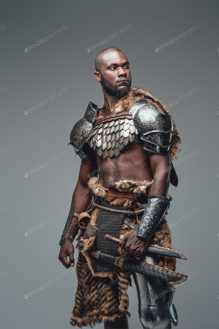 African fighter in viking style dressed in antique protective clothing