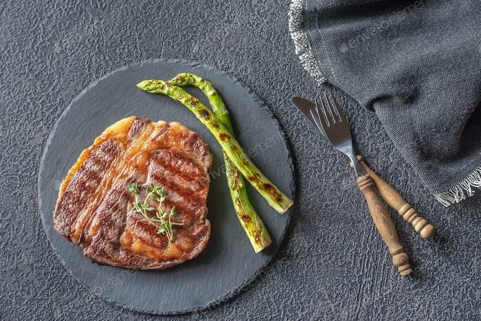 Grilled beef steak with asparagus