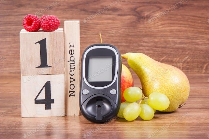 Datum 14 November als Symbol der Welt Diabetes-Tag, Glukometer zur Messung des Zuckerspiegels und der Früchte