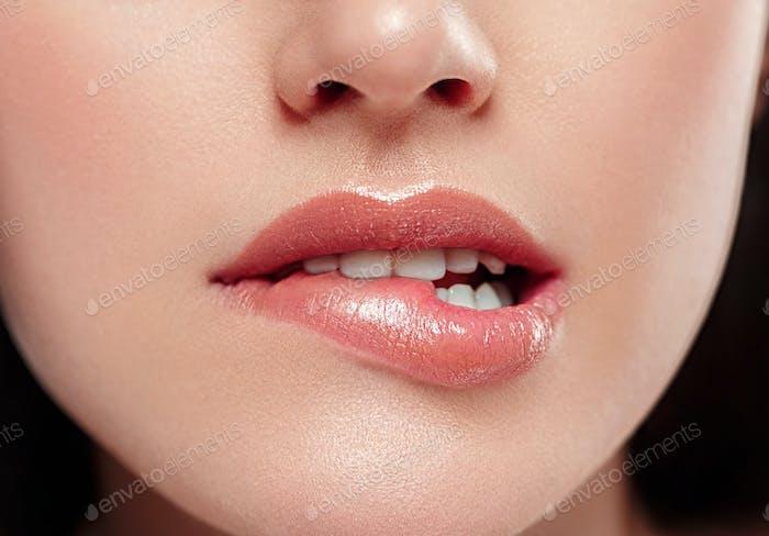 Woman lips mouth biting lip colorful pink