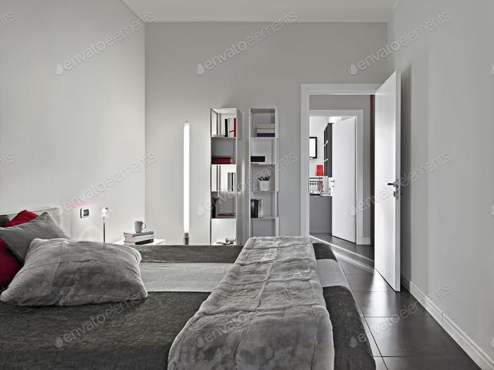 Modern Bedroom Interior with Pillows on the Bed