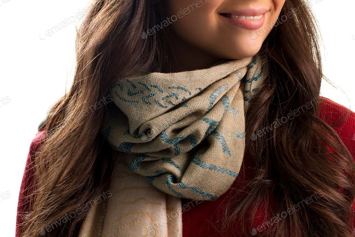Beige scarf on woman's neck
