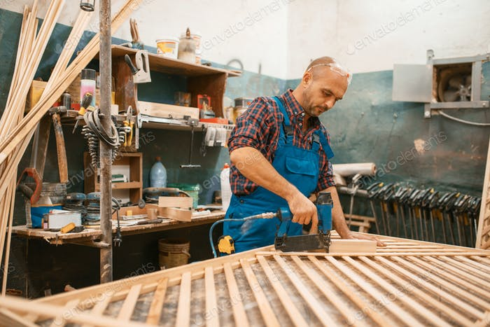 Carpenter, wood processing on furniture factory