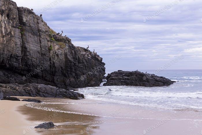 Sandy beach and rocks, Todos Santos, Mexico.