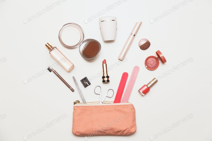 The contents of women's handbags. Make up bag with cosmetics