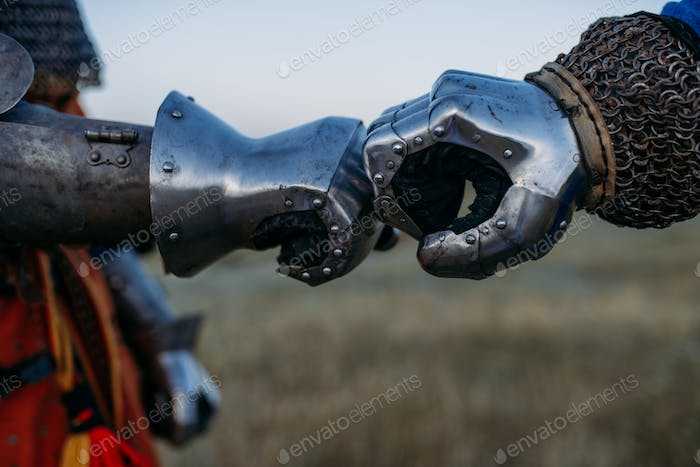 Medieval knights hands in metal gloves