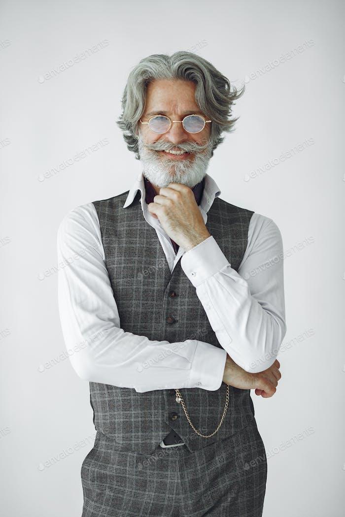 Handsome pensive mature businessman in formal suit