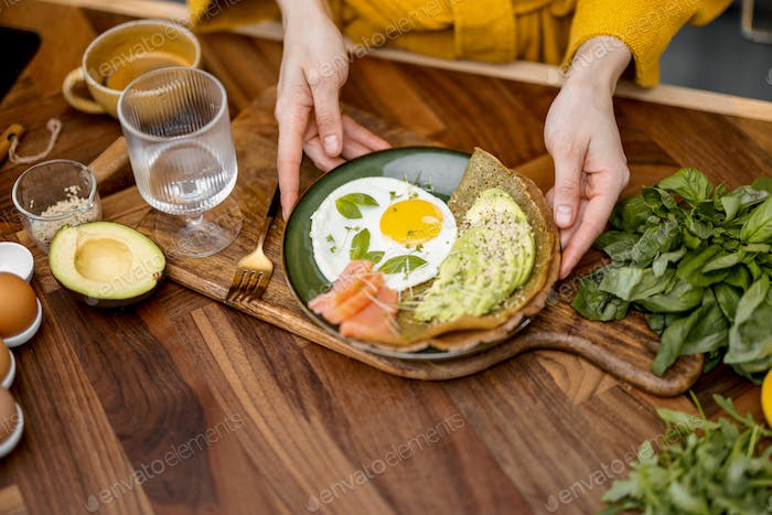 Eggs with fish and avocado for breakfast