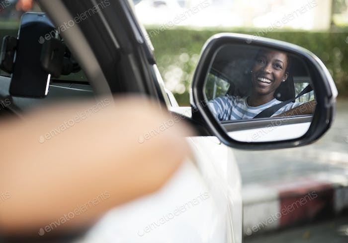 Happy woman in a car