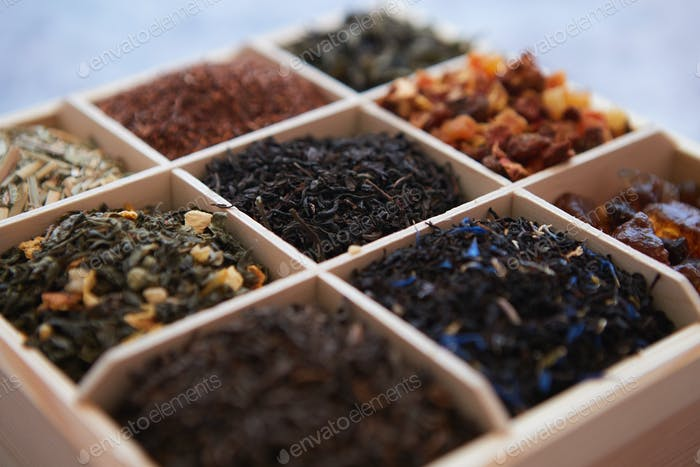 Various kind of dry tea in wooden box