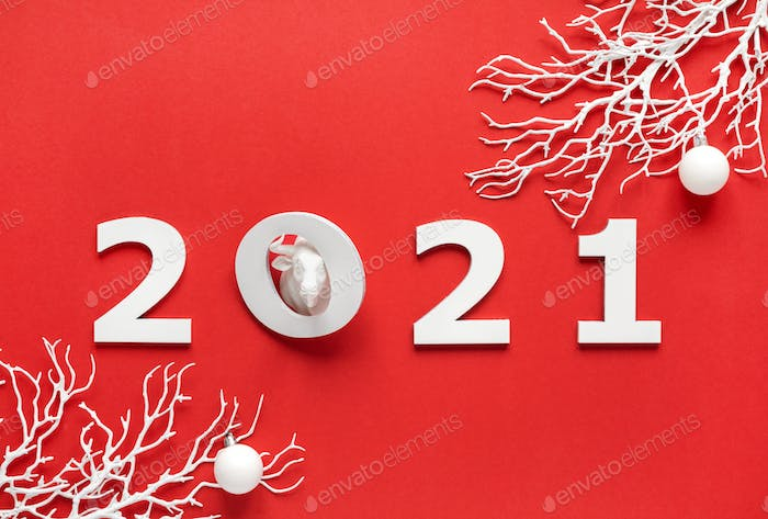 White bull symbol of New Year on a red background.