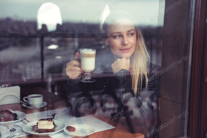 Pretty woman drinking latte