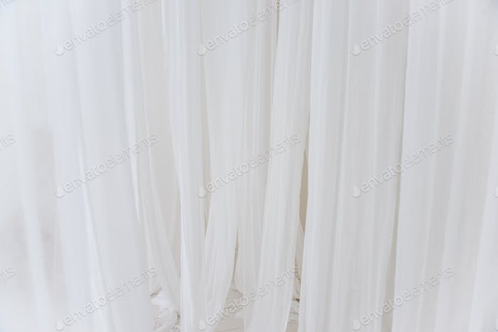 Background texture of white, airy stripes of chiffon fabric, tulle. Neutral colors.