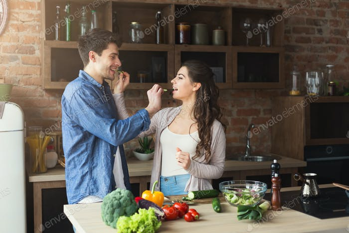 Happy couple cooking healthy food together