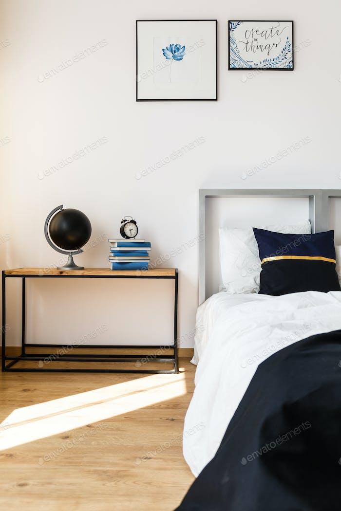 Wooden nightstand in bedroom