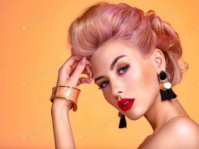 Beautiful woman with creative hairstyle, vivid makeup. Fashionable girl.