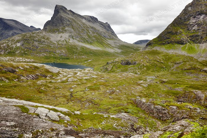 Norwegian green mountain landscape with lake. Norway highlight. Horizontal